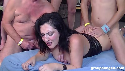 Gorgeous brunette gets her wet pussy filled with more than one penis