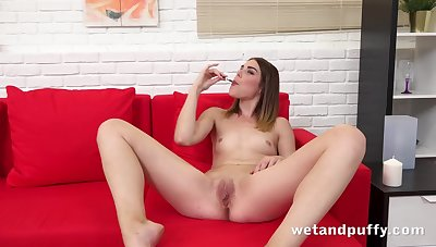 Cutie pumps her cunt with a big black dildo