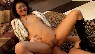 An impossibly naff Asian nympho facesits her man before sucking his cock