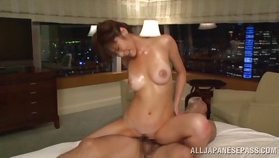 Oiled Sara Yurika gets her pussy banged by a dude on the bed
