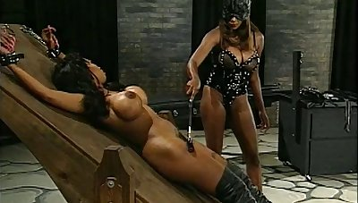Tattooed babe plays slave harrowing and spanked in a nasty BDSM shoot