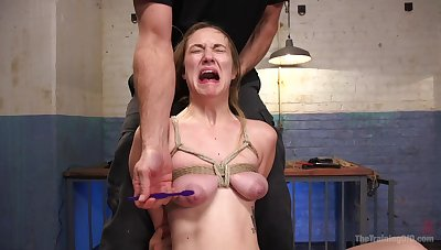 Busty girl screams beside sting during rough maledom BDSM