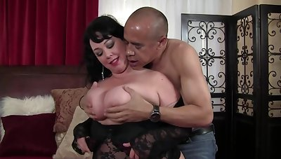 Mature brunette with massive tits is getting her daily dose of intrigue b passion from a black mendicant