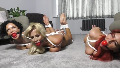 3 beautiful girls robbers bound on floor with gags