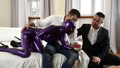 Costumed Lucy Latex gets her pussy filled with a big friend's boner